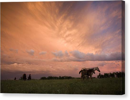 Prairie Sunsets Canvas Print - A Receding Thunderstorm Creates by Jim Richardson