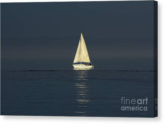 A Sailboat Capturing Light Canvas Print