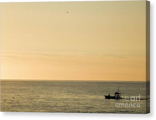 A Small Fishing Boat In Sunset Over Cardigan Bay Aberystwyth Ceredigion West Wales Canvas Print