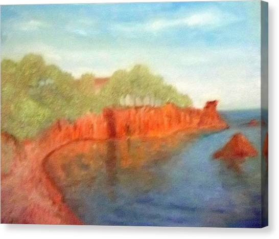 A Small Inlet Bay With Red Orange Rocks Canvas Print