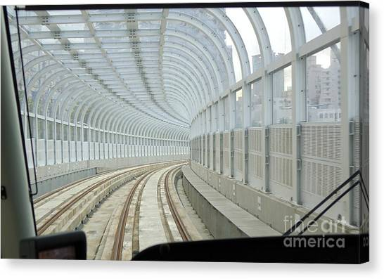 Light Rail Canvas Print - A Streetcar Moves Drives On A Covered Track by Yali Shi