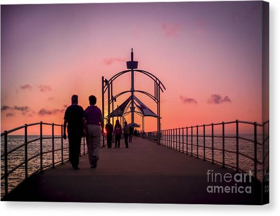Canvas Print featuring the photograph A Stroll Along Sunset Pier by Ray Warren