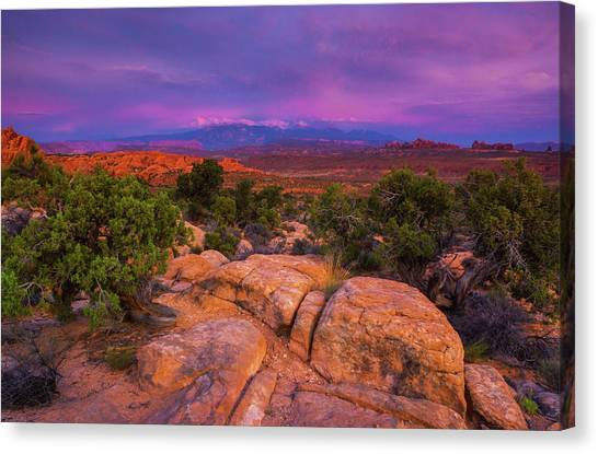 Canvas Print featuring the photograph A Sunset Over Arches by John De Bord