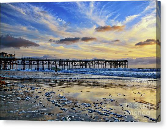 A Surfer Heads Home Under A Cloudy Sunset At Crystal Pier Canvas Print