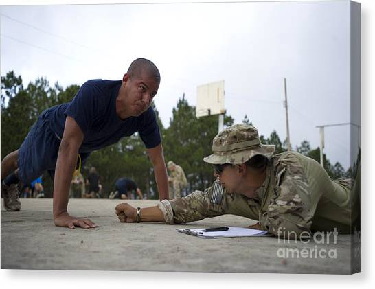 Green Berets Canvas Print - A Tigres Commando Conducts Push-ups by Stocktrek Images