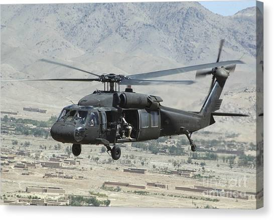 Canvas Print featuring the photograph A Uh-60 Blackhawk Helicopter by Stocktrek Images