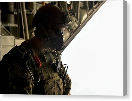 Green Berets Canvas Print - A U.s. Army Green Beret Waits To Jump by Stocktrek Images