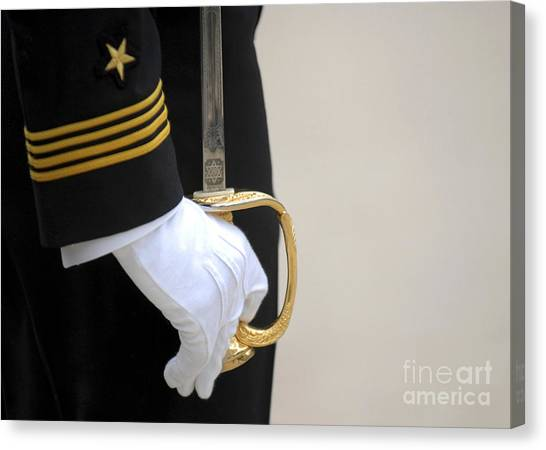 Canvas Print featuring the photograph A U.s. Naval Academy Midshipman Stands by Stocktrek Images