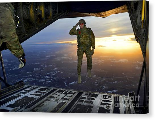 Skydiving Canvas Print - A U.s. Soldier Salutes His Fellow by Stocktrek Images