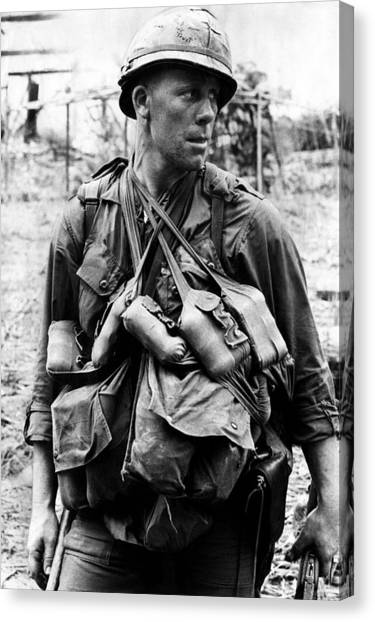 Vietnam War Canvas Print - A U.s. Soldier With The U.s. 1st by Everett