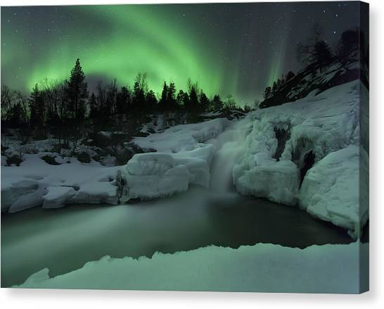 Canvas Print featuring the photograph A Wintery Waterfall And Aurora Borealis by Arild Heitmann