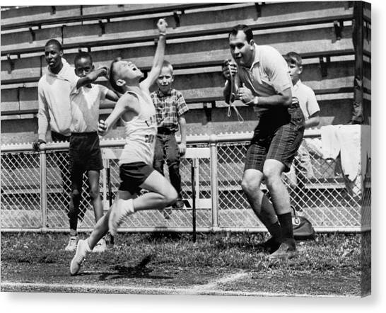 Finish Line Canvas Print - A Young Athlete Sprinting by Underwood Archives