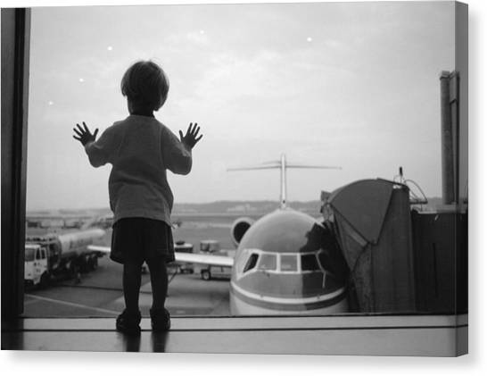 D.c. United Canvas Print - A Young Boy Watches Airplanes by Joel Sartore