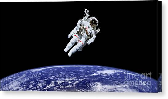 Space Suit Canvas Print - Above Earth by Delphimages Photo Creations