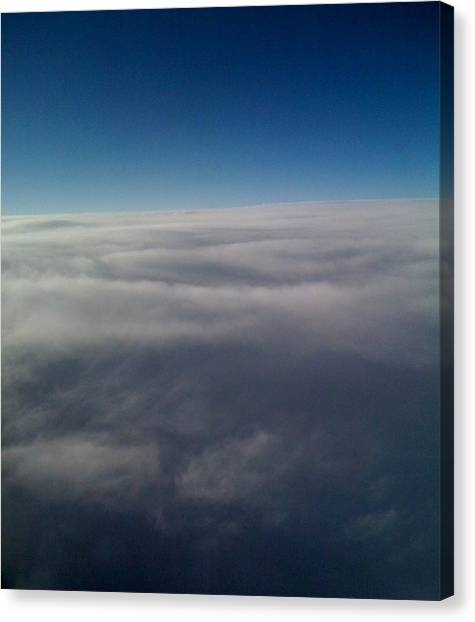 Above The Clouds Canvas Print by Veronica Trotter