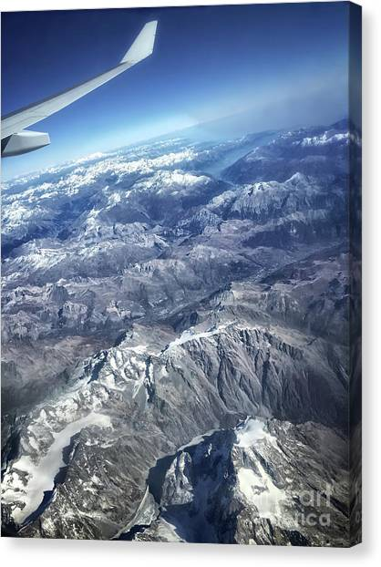 above the Swiss Alps Canvas Print by HD Connelly