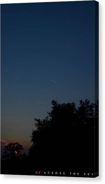 Across The Sky Canvas Print by Jonathan Ellis Keys