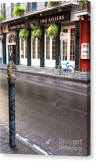Across The Street In The French Quarter Canvas Print by John Rizzuto