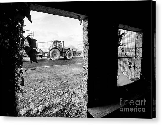 Brexit Canvas Print - agricultural traffic passing disused old Irish Customs post on the irish border by Joe Fox