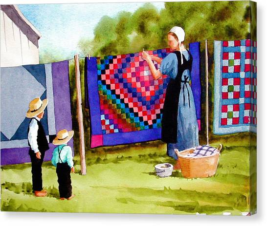 Airing The Quilts Canvas Print by Faye Ziegler