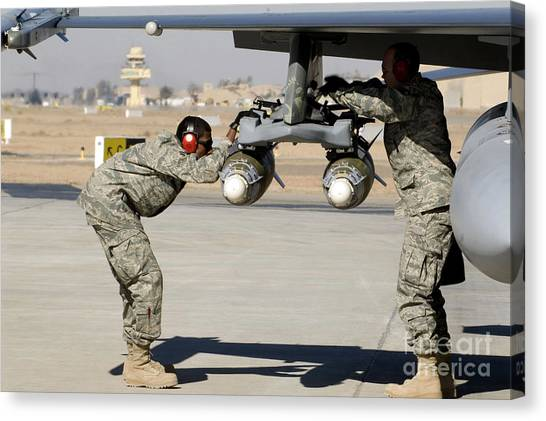 Warheads Canvas Print - Airmen Inspect F-16 Fighting Falcon by Stocktrek Images