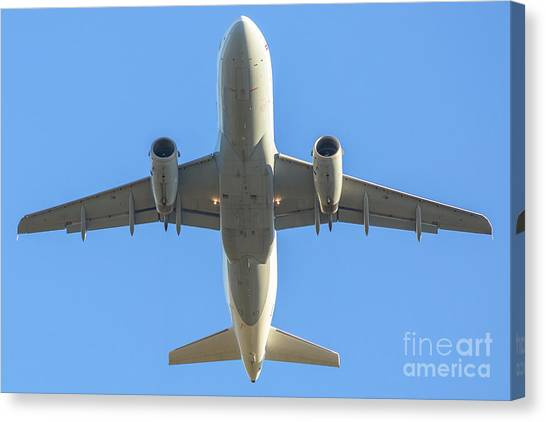Airplane Isolated In The Sky Canvas Print
