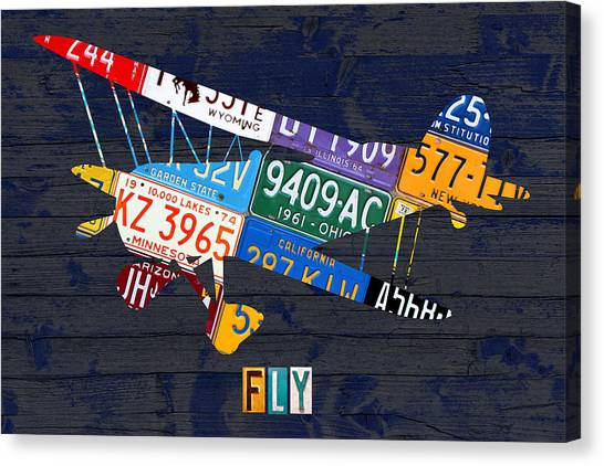 Biplane Canvas Print - Airplane Vintage Biplane Silhouette Shape Recycled License Plate Art On Blue Barn Wood by Design Turnpike