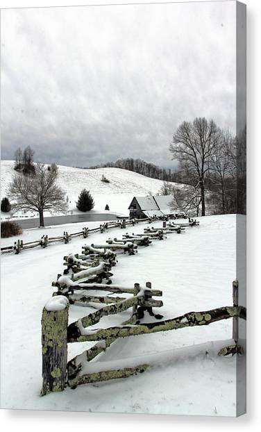 Along The Locust Rails In Winter Canvas Print
