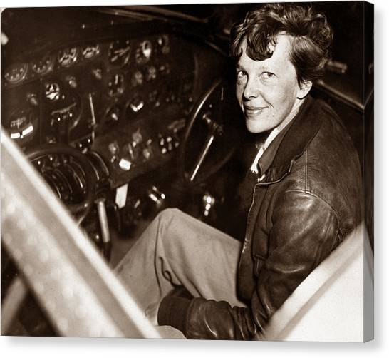 Aviators Canvas Print - Amelia Earhart Sitting In Airplane Cockpit by War Is Hell Store