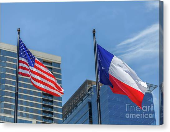 American And Texas Flag On Top Of The Pole Canvas Print