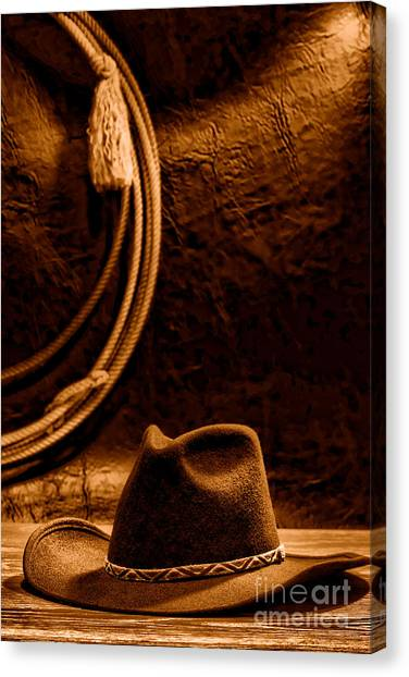 Lassos Canvas Print - American West Rodeo Cowboy Hat And Lasso - Sepia by Olivier Le Queinec
