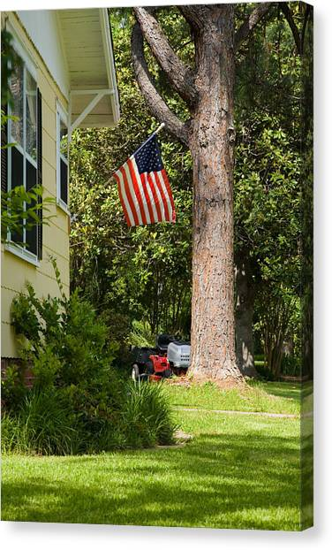 Mls Canvas Print - Americna Flag Hanging In Front Of A Home  by Scott Hales