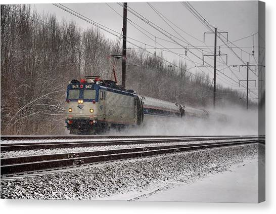 Amtrak In Snowstorm Canvas Print