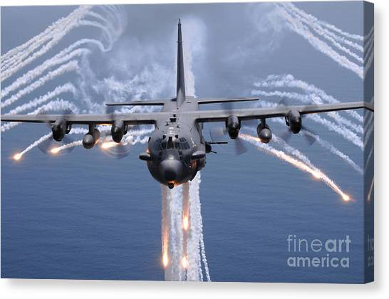 Canvas Print featuring the photograph An Ac-130h Gunship Aircraft Jettisons by Stocktrek Images