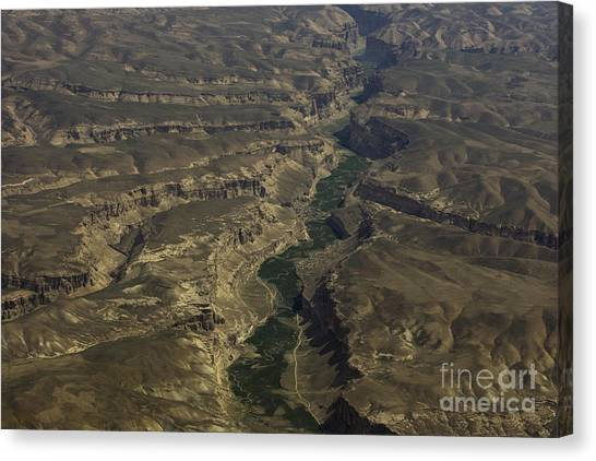 An Afghan Valley Canvas Print by Tim Grams