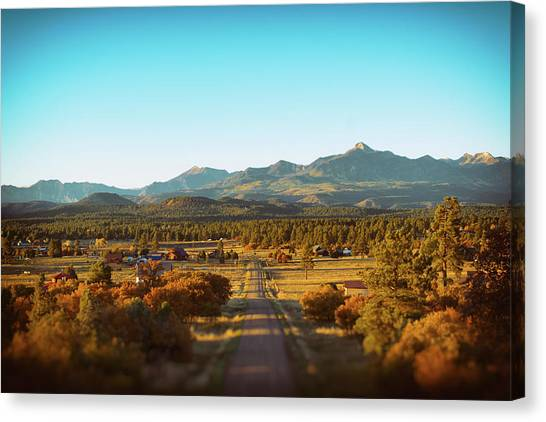 Canvas Print featuring the photograph An Autumn Evening In Pagosa Meadows by Jason Coward