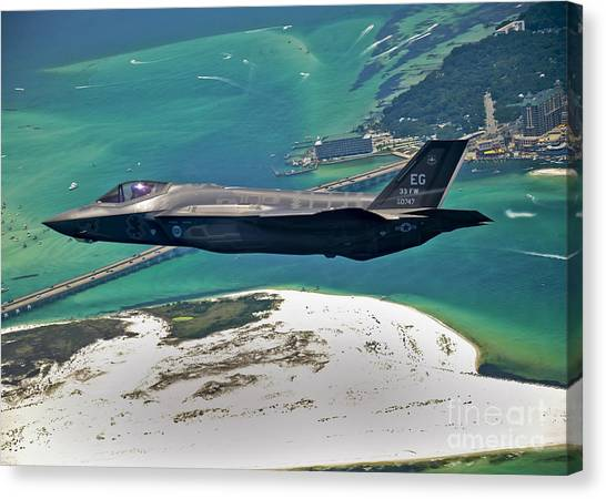 The Sky Canvas Print - An F-35 Lightning II Flies Over Destin by Stocktrek Images