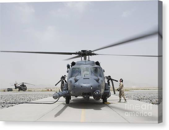 Medivac Canvas Print - An Hh-60 Pave Hawk Lands After A Flight by Stocktrek Images