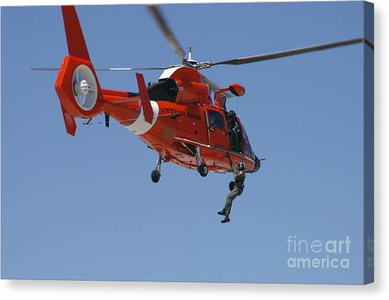 Medivac Canvas Print - An Hh-65c Dolphin Demonstrates by Stocktrek Images