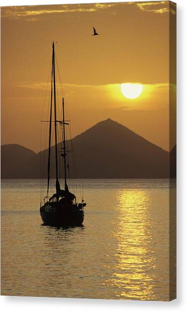 Anchored Ketch And Sunset Over Caribbean Canvas Print