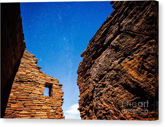 Canvas Print featuring the photograph Ancient Native American Pueblo Ruins And Stars At Night by Bryan Mullennix