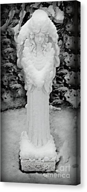 Angel In The Snow Canvas Print