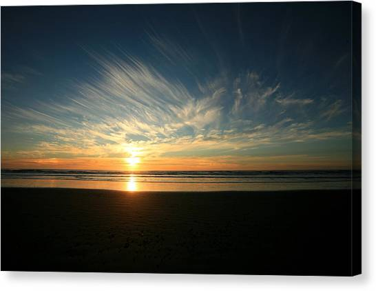 April Beach Sunset Canvas Print by Mike Coverdale