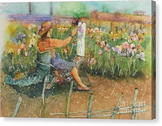 Artist In The Iris Garden Canvas Print