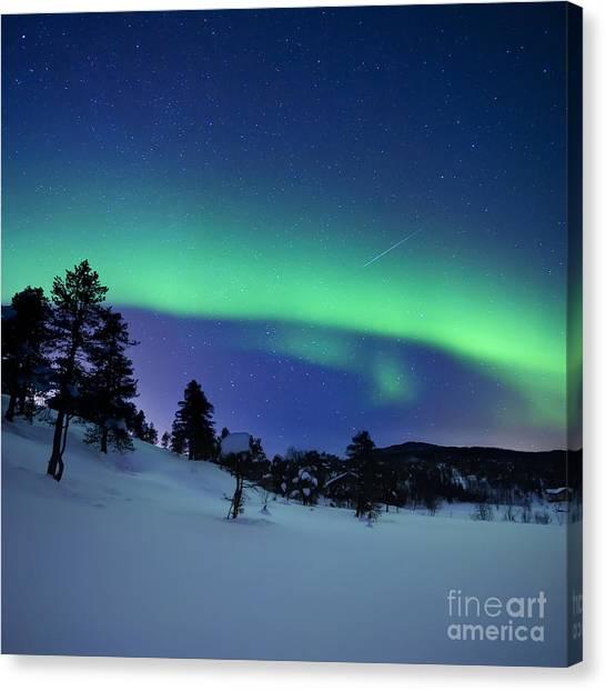 Shooting Stars Canvas Print - Aurora Borealis And A Shooting Star by Arild Heitmann