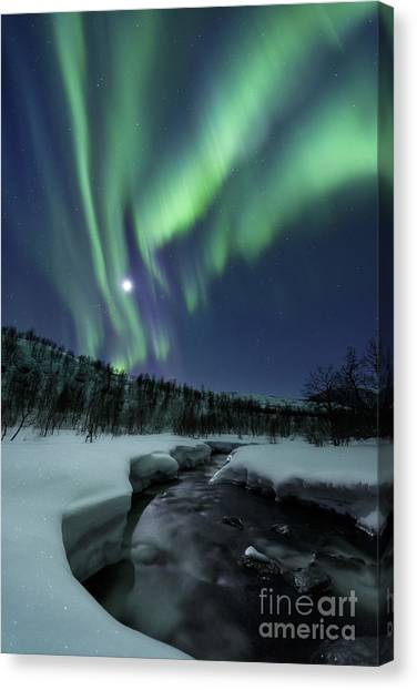 Canvas Print featuring the photograph Aurora Borealis Over Blafjellelva River by Arild Heitmann
