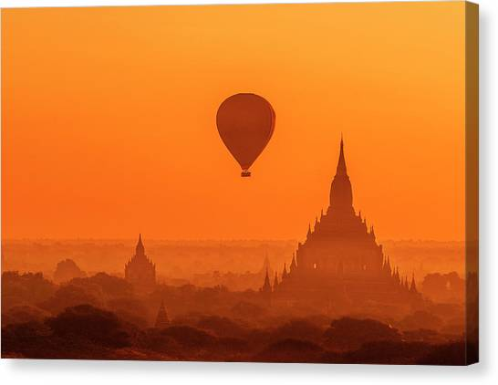 Canvas Print featuring the photograph Bagan Pagodas And Hot Air Balloon by Pradeep Raja Prints