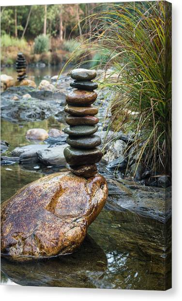Mystic Setting Canvas Print - Balancing Zen Stones In Countryside River Vi by Marco Oliveira