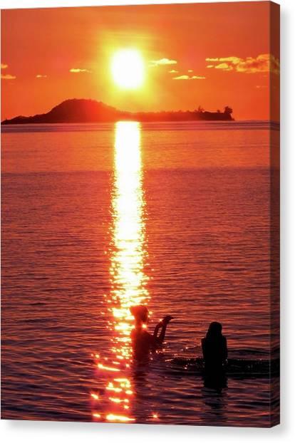 Bathing At Sunset Canvas Print