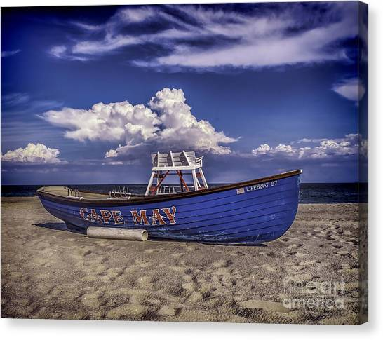 Beach And Lifeboat Canvas Print